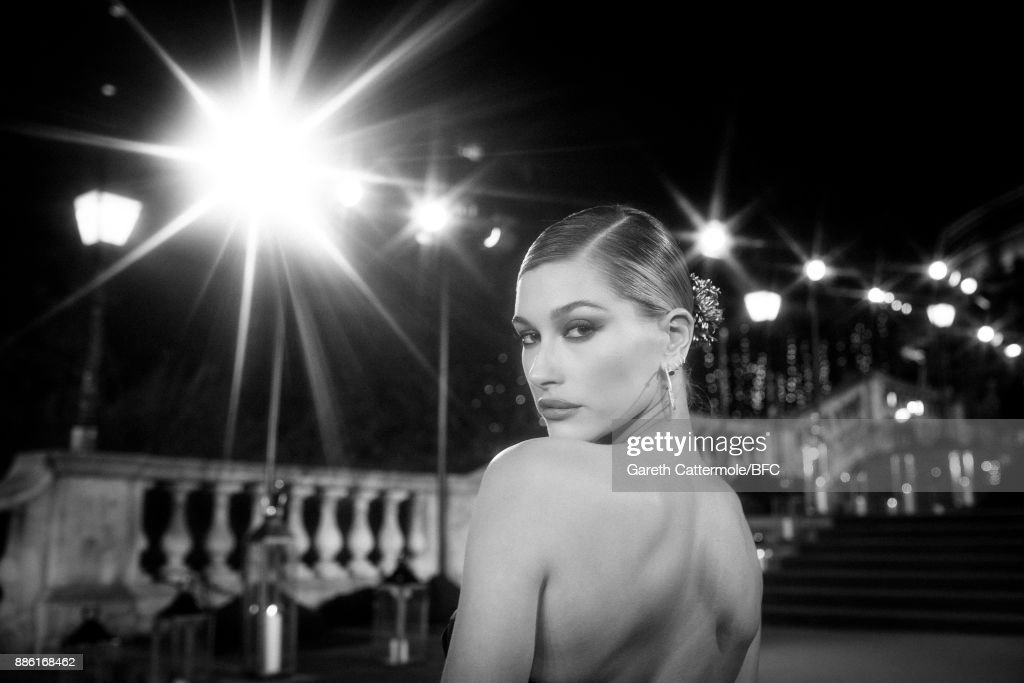 Hailey Baldwin walks the red carpet during The Fashion Awards 2017 in partnership with Swarovski at Royal Albert Hall on December 4, 2017 in London, England.