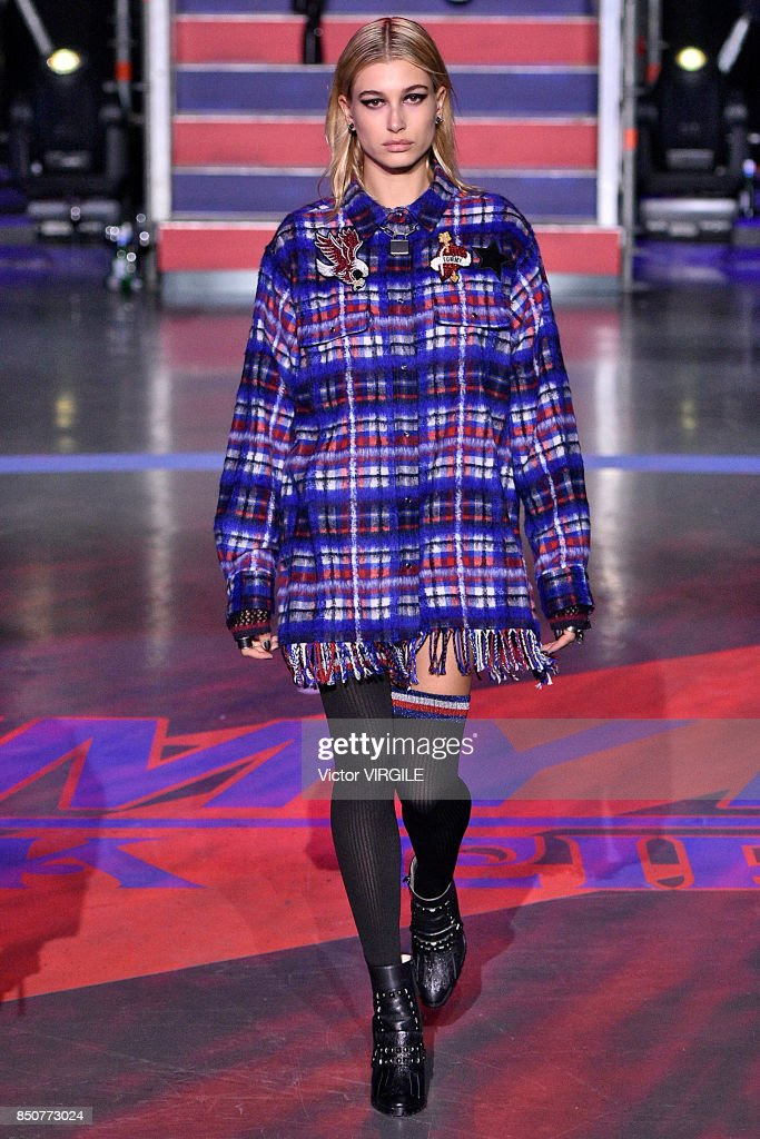 Hailey Baldwin walks the runway at the Tommy Hilfiger Ready to Wear Spring/Summer 2018 fashion show during London Fashion Week September 2017 on September 19, 2017 in London, England