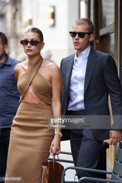 Hailey Bieber and Justin Bieber are seen coming out of a restaurant on June 21, 2021 in Paris, France.