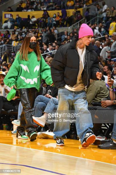 Hailey Bieber and Justin Bieber attend the Phoenix Suns game against the Los Angeles Lakers on October 22, 2021 at STAPLES Center in Los Angeles,...