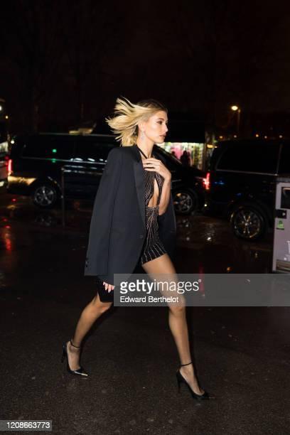 Hailey Bieber Baldwin is seen outside the Yves Saint Laurent show, during Paris Fashion Week Womenswear Fall/Winter 2020/2021, on February 25, 2020...