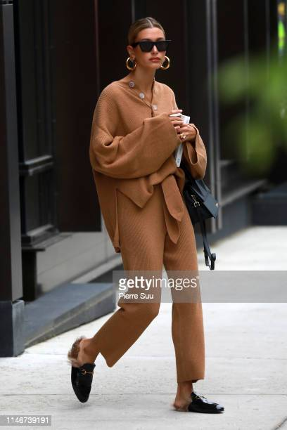 Hailey Bieber comes out of her Brooklyn apartment on May 03, 2019 in New York City.