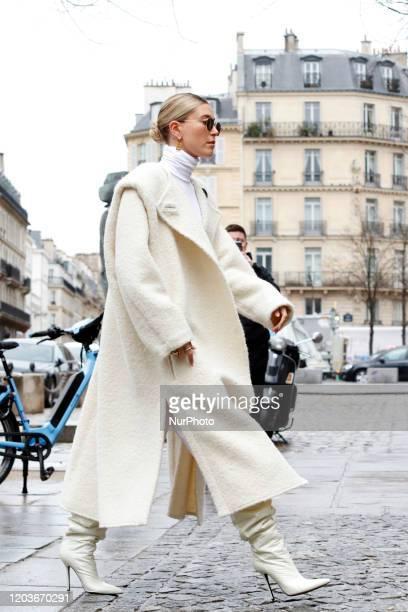 Hailey Bieber is seen wearing creme white cardigan, knitted skirt and top, Bottega bag during Paris Fashion Week Womenswear Fall/Winter 2020/2021 :...