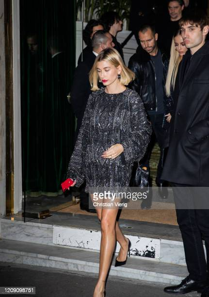 Hailey Bieber is seen wearing paillette dress at the YSL Exhibition during Paris Fashion Week Womenswear Fall/Winter 2020/2021 Day Four on February...