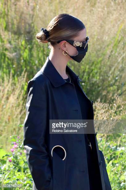 Hailey Bieber, wearing a face mask and sunglasses, is seen during the Milan Women's Fashion Week on September 27, 2020 in Milan, Italy.