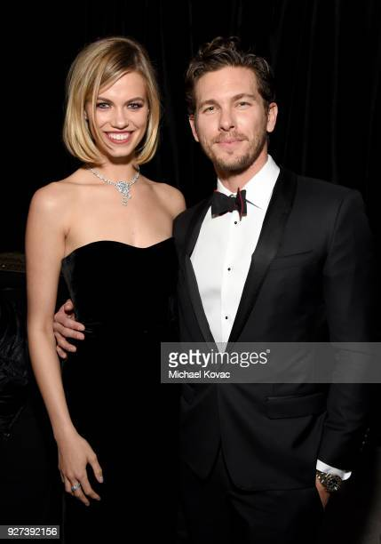 Hailey Clauson and Adam Senn attend the 26th annual Elton John AIDS Foundation Academy Awards Viewing Party sponsored by Bulgari celebrating EJAF and...