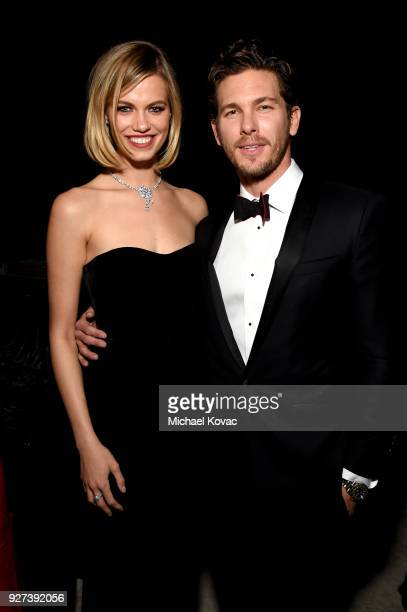 Hailey Clauson and Adam Senn attends the 26th annual Elton John AIDS Foundation Academy Awards Viewing Party sponsored by Bulgari celebrating EJAF...