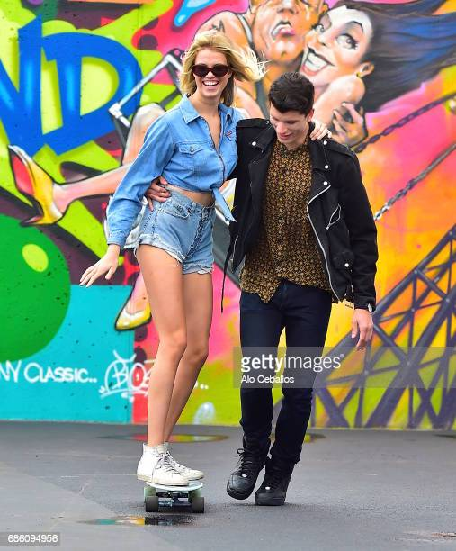 Hailey Clauson and Julian Herrera are seen at the Coney Island Art Walls on May 20 2017 in New York City