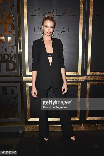 Hailey Clauson attends the Gold Obsession Party L'Oreal Paris Photocall as part of the Paris Fashion Week Womenswear Spring/Summer 2017 on October 2...