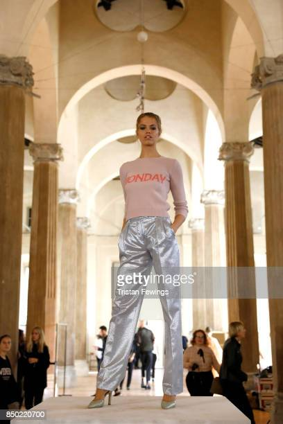 Hailey Clauson is seen backstage ahead of the Alberta Ferretti show during Milan Fashion Week Spring/Summer 2018on September 20 2017 in Milan Italy