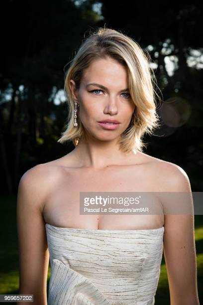 Hailey Clauson poses for portraits at the amfAR Gala Cannes 2018 cocktail at Hotel du CapEdenRoc on May 17 2018 in Cap d'Antibes France