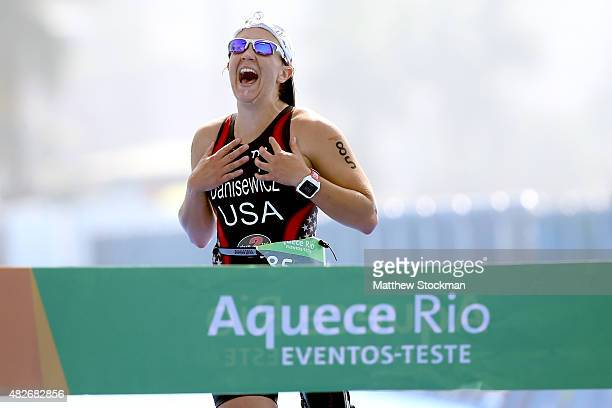 Hailey Danisewicz of the United States crosses the finish line to win the PT2 class during the Aquece Rio Paratriathlon at Copacabana beach on August...