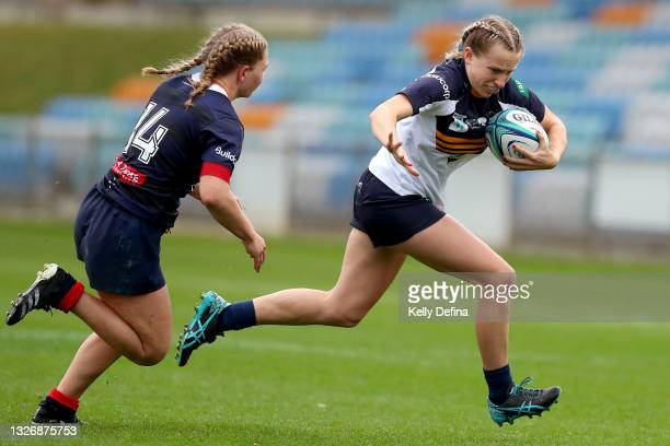 Hailey Derera of the Brumbies runs with the ball during the Super W match between the Melbourne Rebels and the ACT Brumbies at Coffs Harbour...