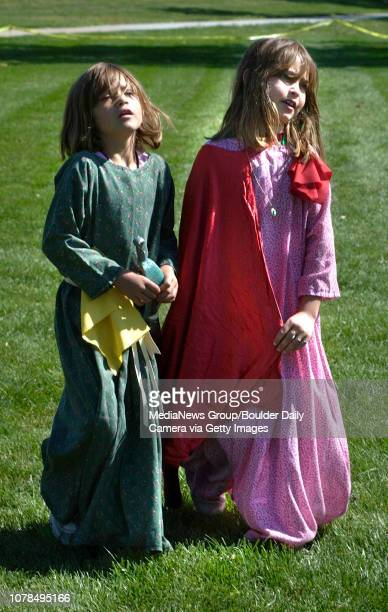 Hailey Michel left and her sister Rachel walk to another challenge at the teen role playing event by Mamie Doud Eisenhower Library on Saturday The...
