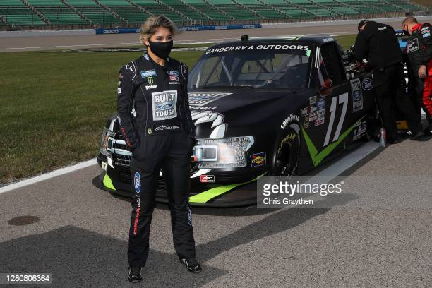 Hailie Deegan driver of the FORD Ford waits on the grid prior to the NASCAR Gander RV Outdoors Truck Series Clean Harbors 200at Kansas Speedway on...