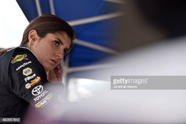 Hailie Deegan driver of the Mobil 1 / NAPA Power Premium Plus Toyota stands next to her car during practice for the NASCAR KN Pro Series West...