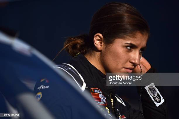 Hailie Deegan driver of the Mobil 1 / NAPA Power Premium Plus Toyota stands next to her car during qualifying for the NASCAR KN Pro Series West...