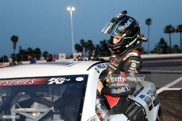 Hailie Deegan driver of the Mobil 1 / Napa Power Premium Plus Toyota gets into her car prior to the start of the NASCAR KN Pro Series West at Orange...