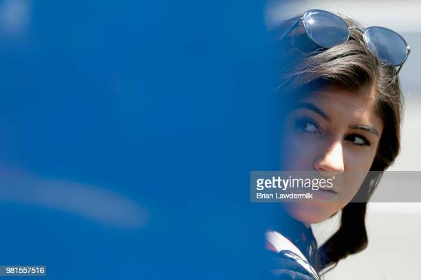 Hailie Deegan driver of the Mobil 1/NAPA Power Premium Plus Toyota stands in the garage area during practice for the NASCAR KN Pro Series West...