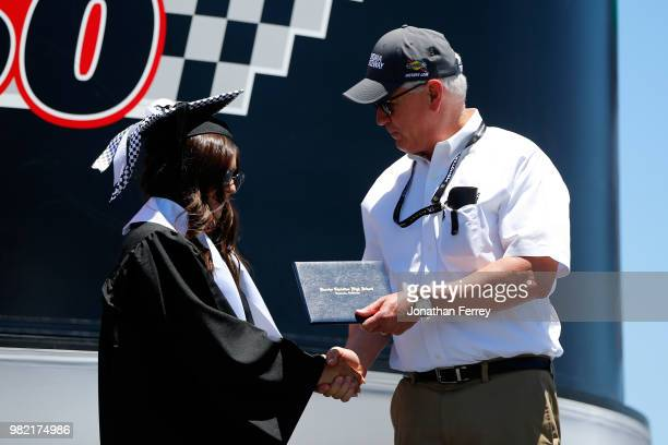 Hailie Deegan driver of the Mobil 1/NAPA Power Premium Plus Toyota receives her diploma on stage prior to the NASCAR KN Pro Series West Carneros 200...