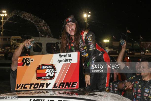 Hailie Deegan driver of the NAPA Power Premium Plus Toyota celebrates her first victory at the conclusion of the NASCAR KN Series West NAPA Auto...