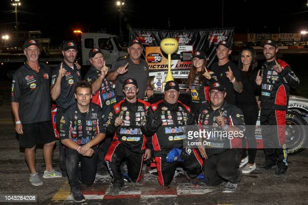 Hailie Deegan driver of the NAPA Power Premium Plus Toyota celebrates a victory with her team at the conclusion of the NASCAR KN Series West NAPA...