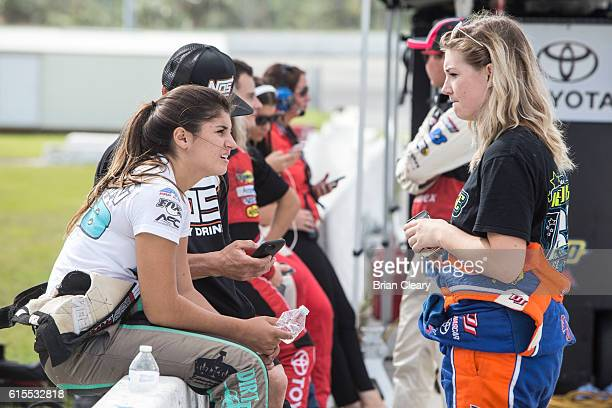 Hailie Deegan L and Hannah Newhouse talk during the NASCAR Drive for Diversity Developmental Program at New Smyrna Speedway on October 18 2016 in New...