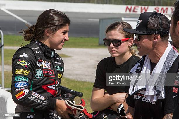 Hailie Deegan L talks to her father R as McKenna Haase looks on at the NASCAR Drive for Diversity Developmental Program at New Smyrna Speedway on...