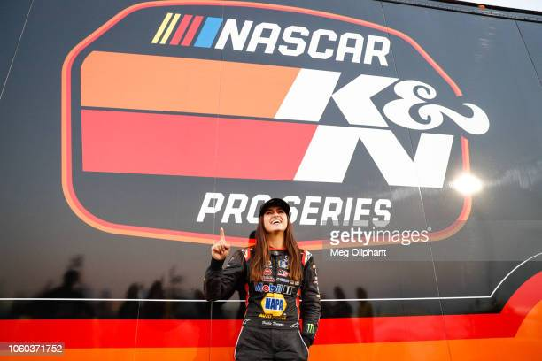 Hailie Deegan poses for a photo after winning the pole at Kern County Raceway Park on October 27 2018 in Bakersfield California