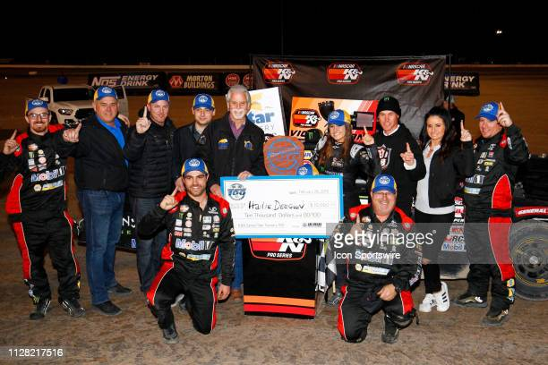 Hailie Deegan Toyota Camry celebrates in victory lane with her crew family and race sponsor from Star Nursery Craig Keough after winning the Star...