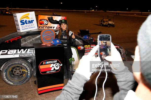 Hailie Deegan Toyota Camry poses for a photo being taken by her father Brian Deegan after winning the Star Nursery 100 NASCAR KN Pro Series West race...
