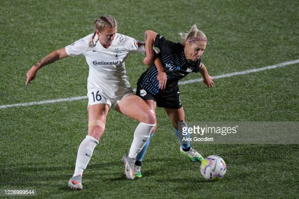 Hailie Mace of North Carolina Courage fights for the ball against McCall Zerboni of Sky Blue FC during a game on day 8 of the NWSL Challenge Cup at...