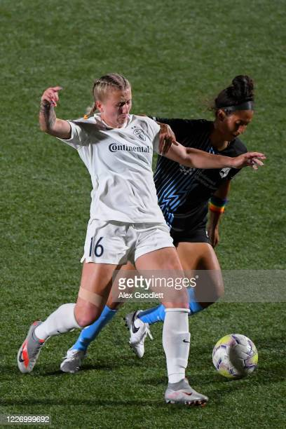 Hailie Mace of North Carolina Courage fights for the ball against Estelle Johnson of Sky Blue FC during a game on day 8 of the NWSL Challenge Cup at...