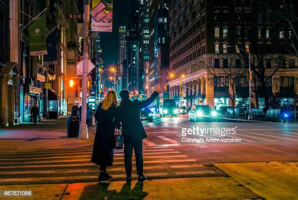 Hailing a cab in Midtown Manhattan at night