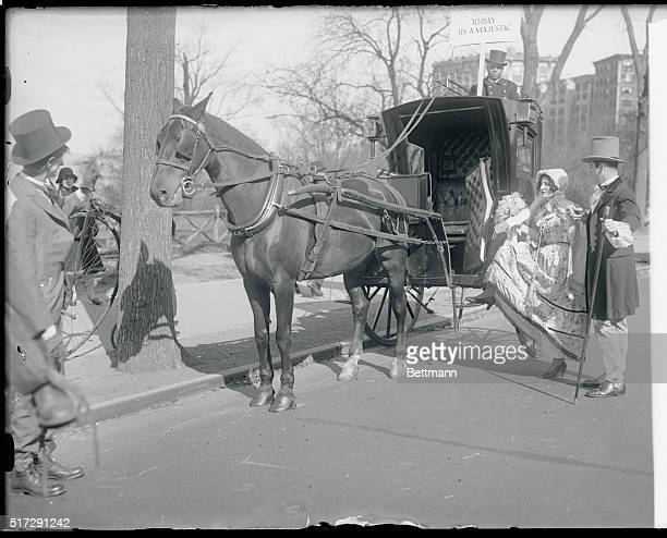 Hailing a cab in the olden days was something like the scene pictured above Jimmy Richards and Edith Ceisler are shown garbed in the manner of 1860...