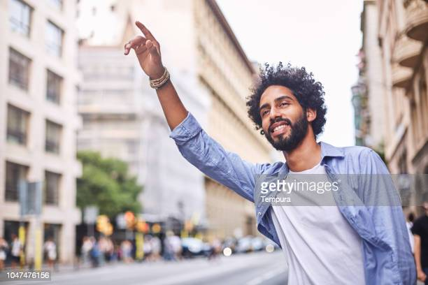 hailing a taxi in the streets of barcelona. - hail stock pictures, royalty-free photos & images