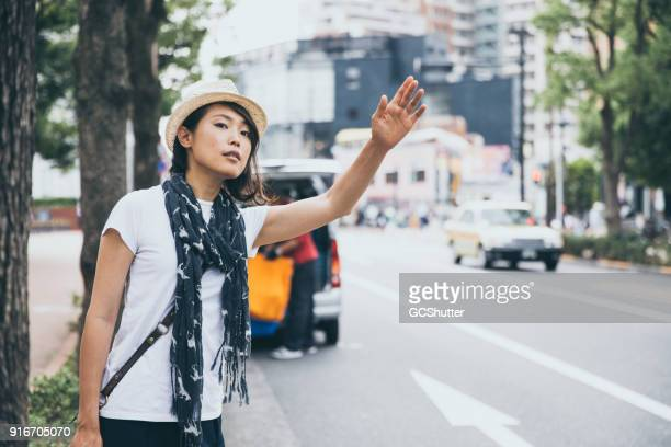 hailing a taxi to get into town - hail stock pictures, royalty-free photos & images