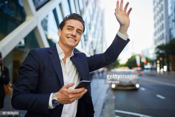 hailing a taxi with a smart phone app. - hail stock pictures, royalty-free photos & images