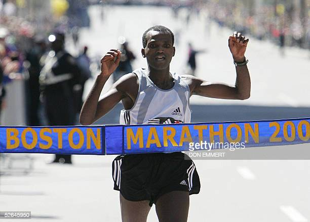 Hailu Negussie of Ethiopia raises his arms as he crosses the finish line to win the 109th running of the Boston Marathon 18 April 2005 in Boston MA...