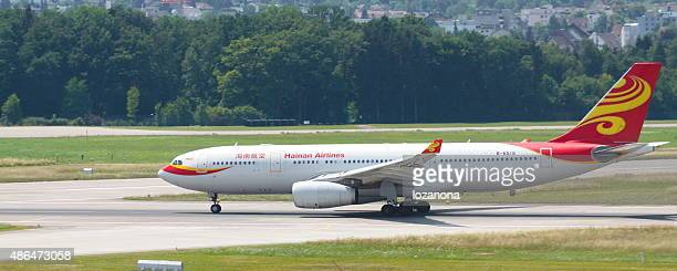 hainan airlines aircraft taking off in zurich airport - hainan island stock pictures, royalty-free photos & images