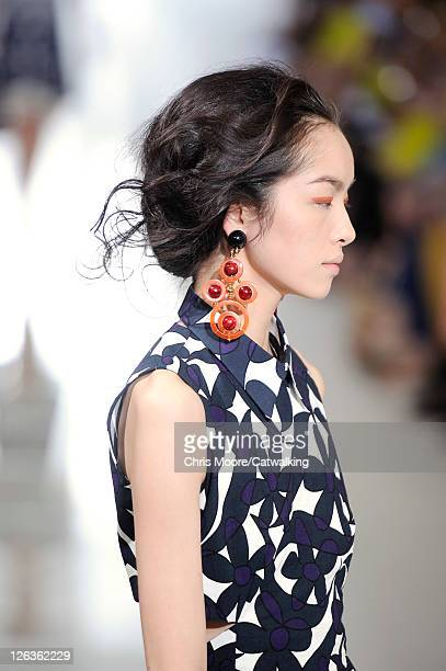 Hair and beauty detail with jewelry on the runway at the Marni Spring Summer 2012 fashion show during Milan Fashion Week on September 25, 2011 in...