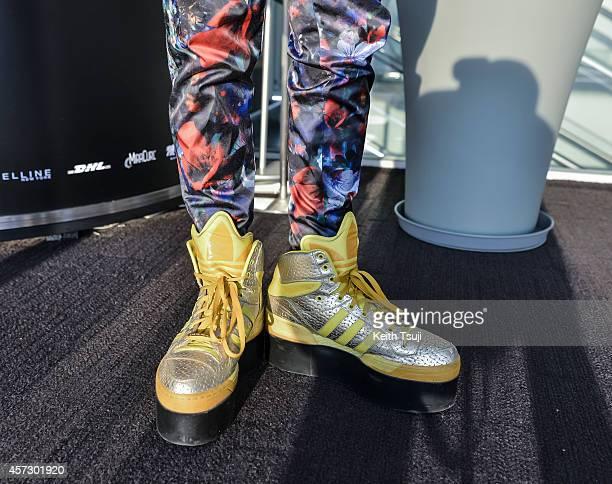 Hair artist Hiroyuki Kato is seen wearing shoes by Jeremy Scott for Adidas during MercedesBenz Fashion Week Tokyo Spring/Summer 2015 at Shibuya...