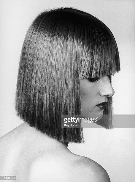 Hair by hairstylist Patrick Ales frames the face with a sharp fringe and a chin length cut