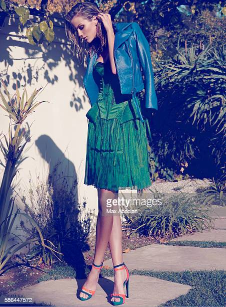 Hair by Tony Chavez and Leonor Greyl makeup by Jo Strettell Jacket by Mikhael Kale dress by Bottega Veneta and shoes by Pierre Hardy
