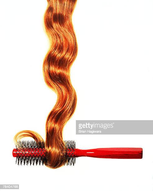hair coiling around brush - hair colour stock pictures, royalty-free photos & images