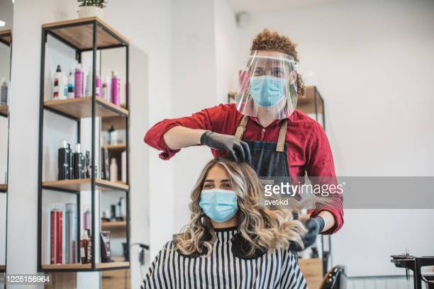 hair cutting during pandemic - hairstyle stock pictures, royalty-free photos & images