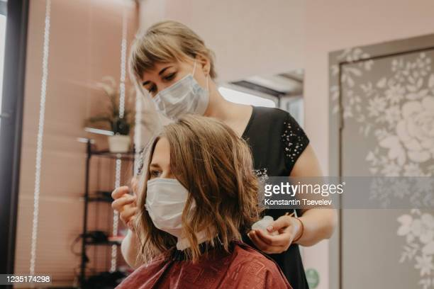 hair cutting during pandemic - beauty salon stock pictures, royalty-free photos & images