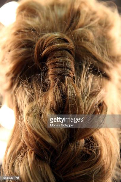 Hair detail as a model prepares backstage at the Ane Amour fashion show during New York Fashion Week at Pier 59 on February 9 2017 in New York City