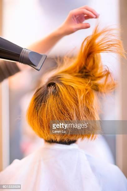 Hair dryer blowing dyed hair
