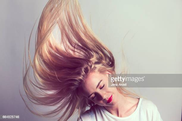 hair flip - long hair stock pictures, royalty-free photos & images